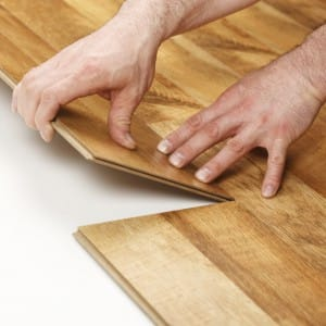 Person fitting laminate flooring