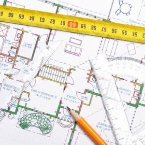 Image of a tape measure and house plan with measurements
