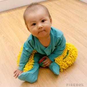 An image of a baby in a mop suit