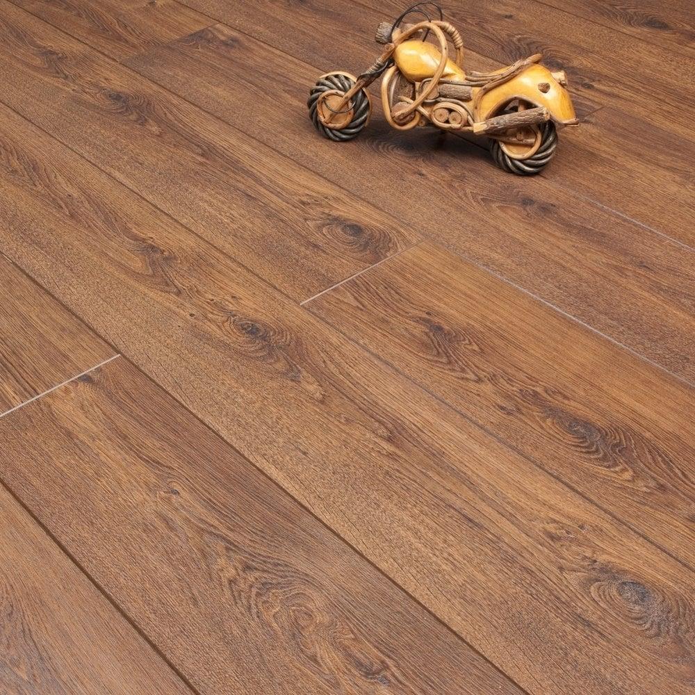 Balterio Tradition Quattro Tasmanian Oak 498 9mm Laminate Flooring V Groove Ac4 1 9218m2