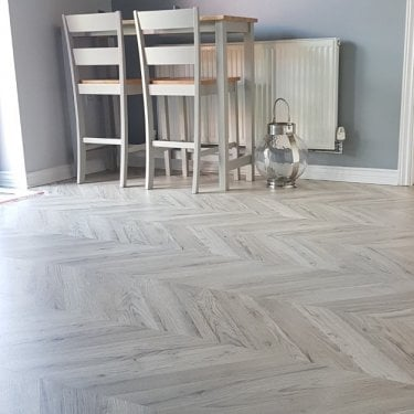 Signature - 8mm Herringbone Laminate Flooring - Light Oak